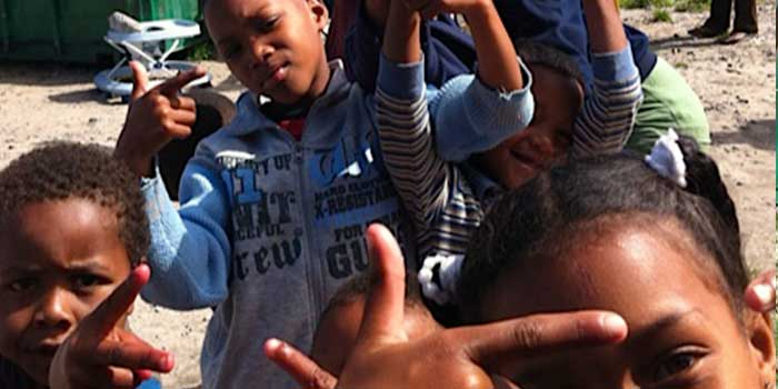 The Cape Flats are notorious for gangs and even the littlest kids know all the gang signs.