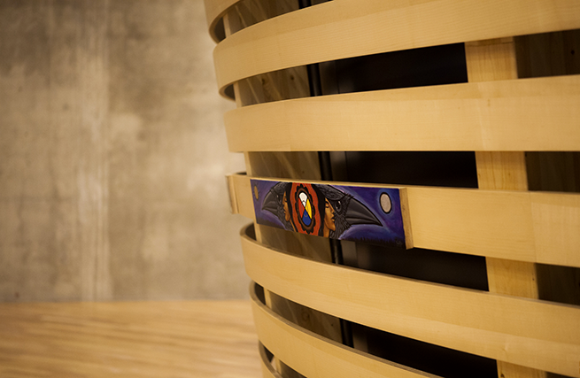 A circular theatre of curved wooden slats, the central focal point in the Indigenous Perspectives gallery, represents the multitude of Canadian Aboriginal traditions.