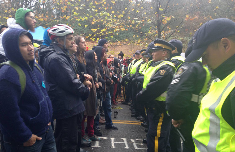 Protesters stand their ground in the face of the RCMP at Burnaby Mountain.