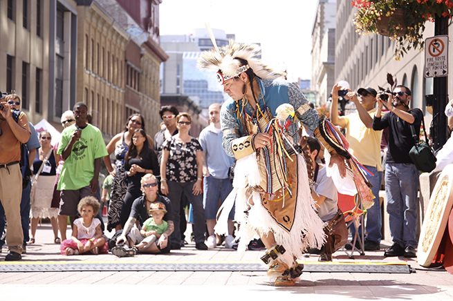 Al Harrington performs during the Peoples' Pow-Wow, held on Sparks St., near the main forum.