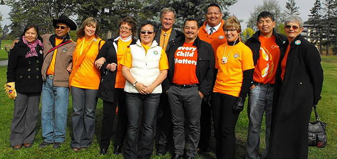 Phyllis Webstad (Centre-Front) with then-Chief of the Assembly of First Nations Shawn A-inchut Atleo at the first Orange Shirt Day, Sept. 30, 2013