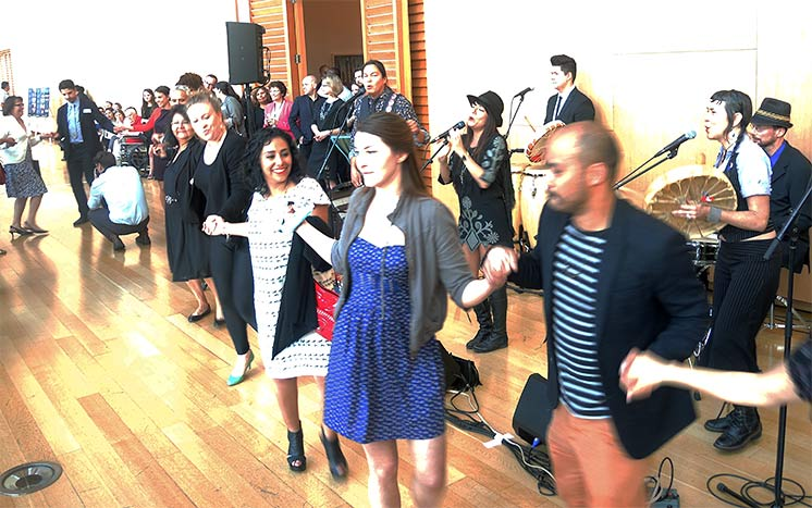 Attendees Taking Part in a Round Dance
