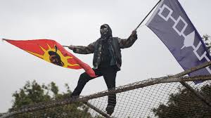 A protester at one of the grassroots movements covered in the film The Grandfather of all Treaties | Image source: tworowtimes.com