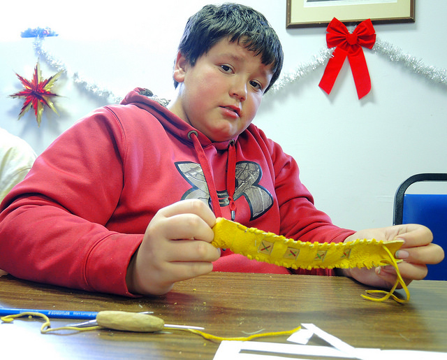 Darrin Bloor shows off the bracelet he just made at the Porcupine Bracelet Making Workshop