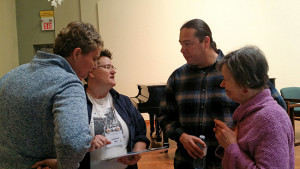 Clayton King with group at art exhibit