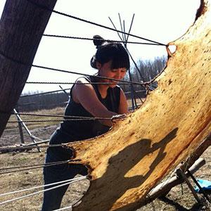 Melaw Nahkehk'o tanning moose hide