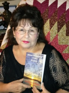 Author June Shawanda Richard with her self-published book of memoirs, Silent Whispers from Within