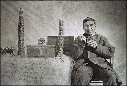 Charles Edenshaw poses with his engraving tool and silver bracelet | Photo by Harlan Ingersoll Smith, 1890/Canadian Museum of Civilization