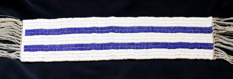 "As the Haudenosaunee and Dutch discovered much about each other, an agreement was made as to how they were to treat each other and live together. Each of their ways would be shown in the purple rows running the length of a wampum belt. ""In one row is a ship with our White Brothers' ways; in the other a canoe with our ways. Each will travel down the river of life side by side. Neither will attempt to steer the other's vessel.""http://www.onondaganation.org/culture/wampum/two-row-wampum-belt-guswenta/"
