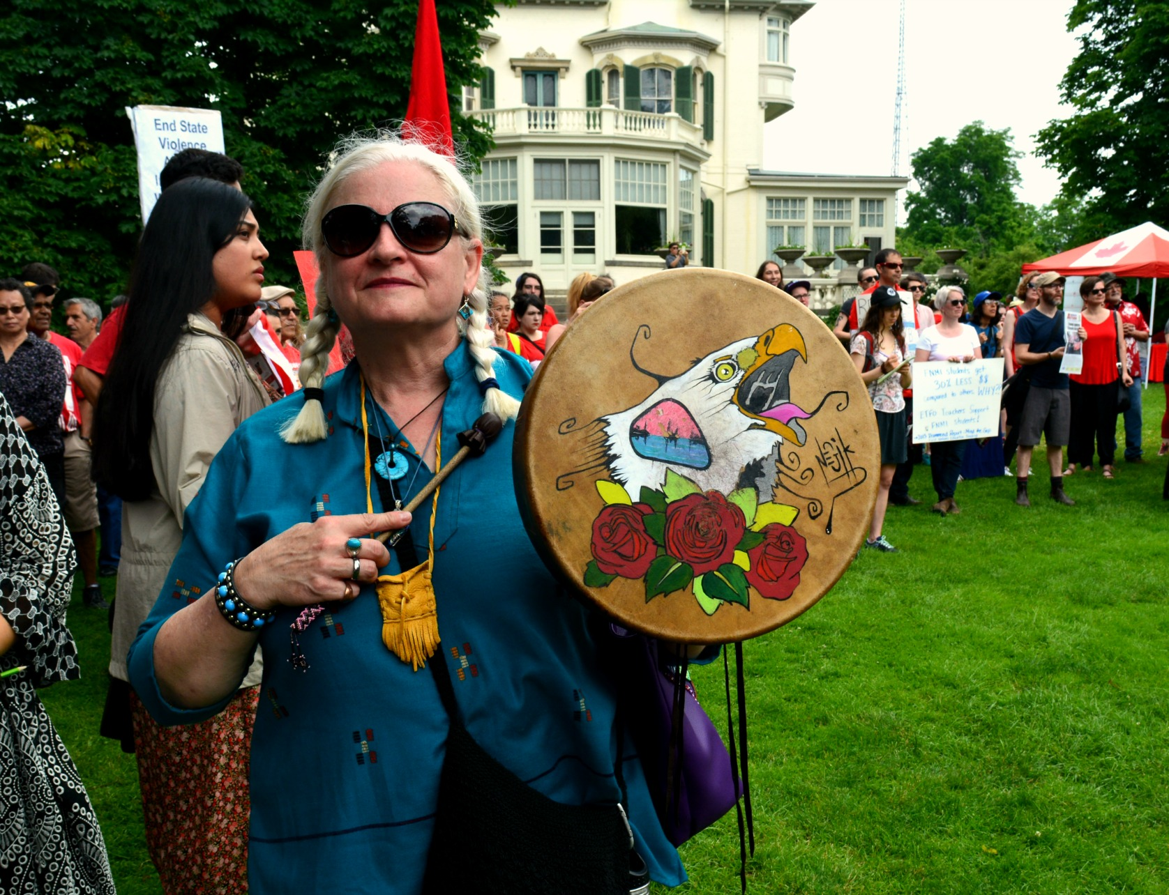 Protester with a beautiful hand painted drum
