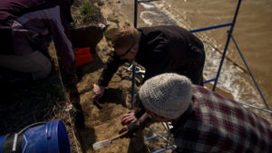 An archaeology team working on an excavation site to find answers for the Solutrean Theory   Image source: Yap Films