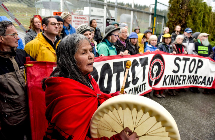 TA'AH AMY GEORGE, GRAND CHIEF STEWART PHILLIP, INDIGENOUS LEADERS AND HUNDREDS OF OTHERS SHUT DOWN WORK AT KINDER MORGAN TERMINAL