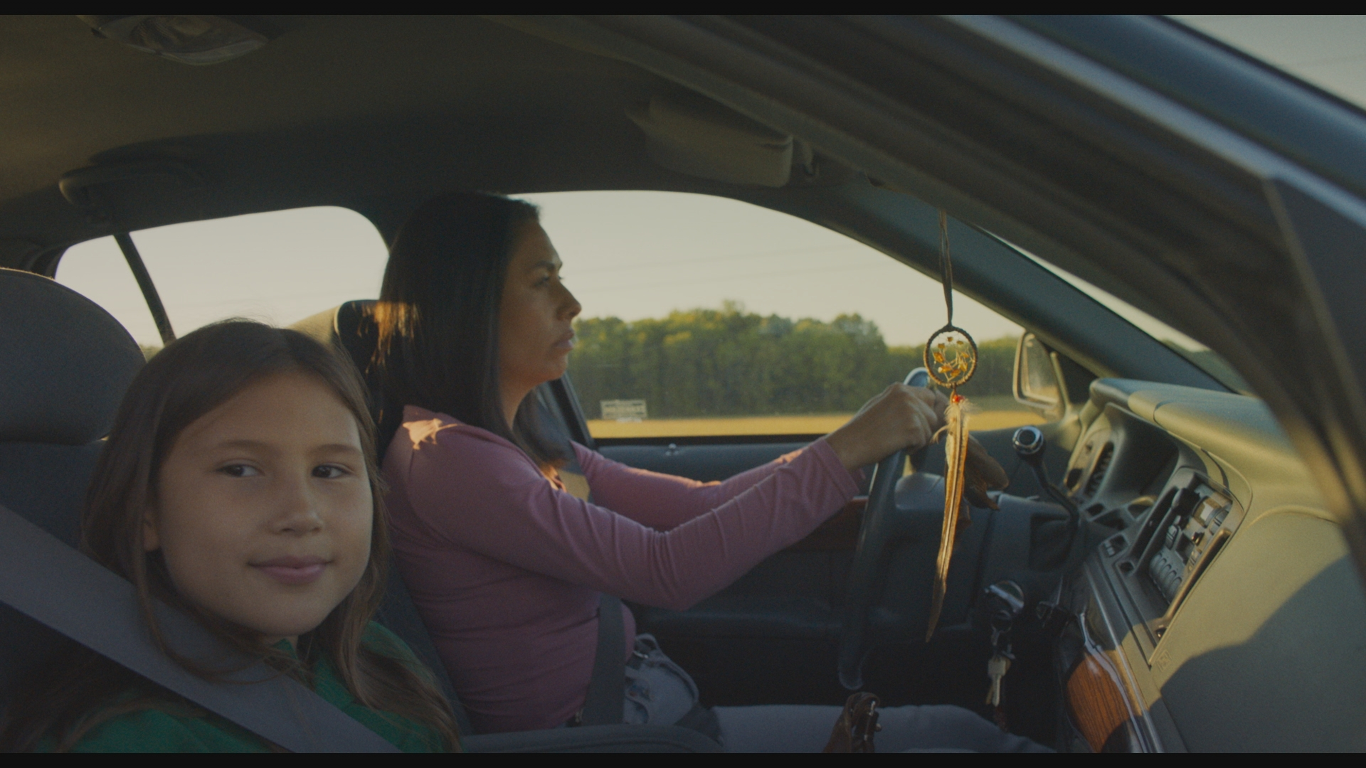 Lake Delisle as Ivy and Carmen Moore as Susan driving in a car