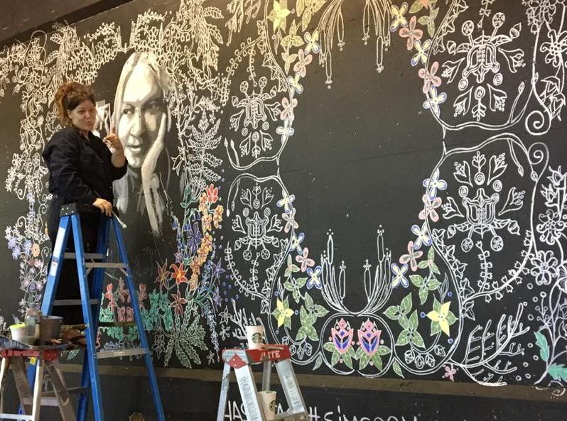 Tannis Nielsen working on the Simcoe Street Mural